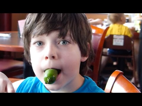 Rowan eats a jalapeno pepper like it's nothing.