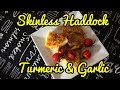 Skinless Haddock with turmeric and garlic and cherry tomatoes
