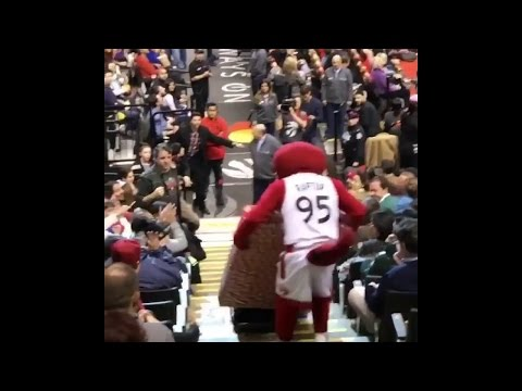 Toronto Raptor's mascot drops prize TV while delivering it to the winning fan