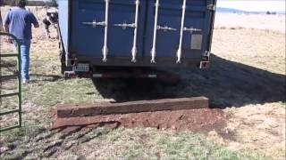Unloading a 40' ISO shipping container