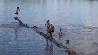 Boy and girl swiming at Seim Reap, Cambodia