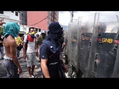 Venezuela protests, strike threat raise heat on Maduro