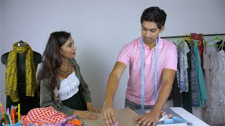 Indian male fashion designer working in his fashion studio - creative profession