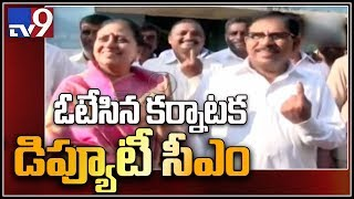 Karnataka Dy CM Parameshwara and his wife cast their votes - T…