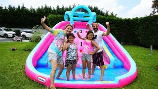 Family fun playing with Inflatable water slide