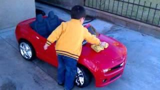Aiden washing His Camaro SS(power wheels)
