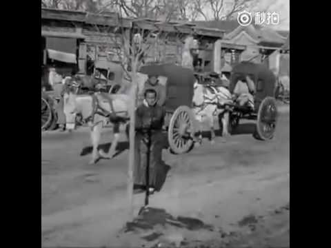The streets and people in Beijing, capital of China, over 100 years ago