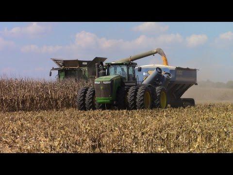 Big John Deere Machines Harvesting Corn