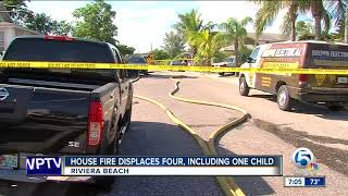 House fire displaces four people in Riviera Beach