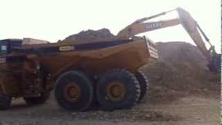 John Deere 450 Excavator filling a Caterpillar 740 Articulated Truck