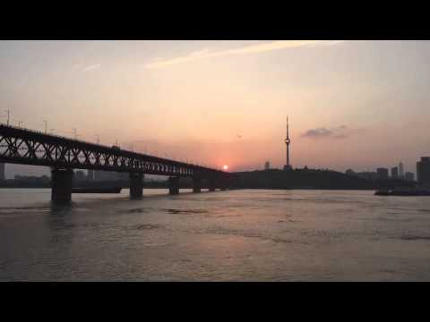 SUNSET OVER THE YANGTZE RIVER IN WUHAN CITY