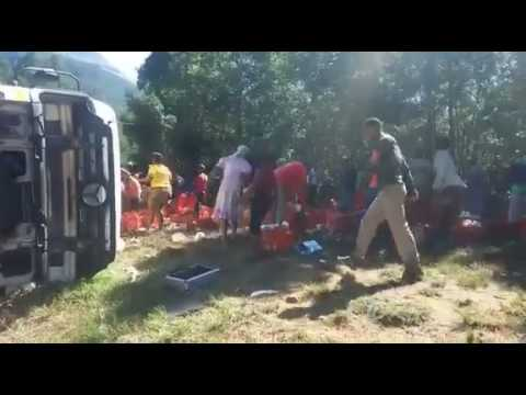 Crowd steals goods from an overturned truck