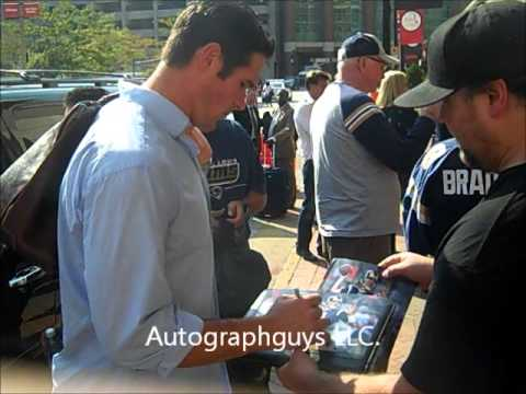 A.J. FEELEY OF THE ST. LOUIS RAMS SIGNING AUTOGRAPHS AFTER A RECENT RAMS HOME GAME