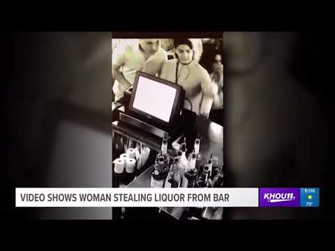 Surveillance video shows woman stealing booze from bar
