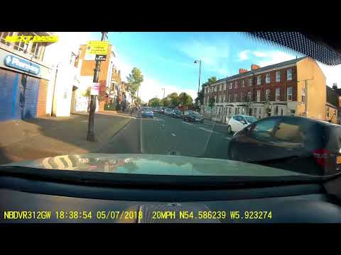 Car driving on pavement Ormeau road Belfast