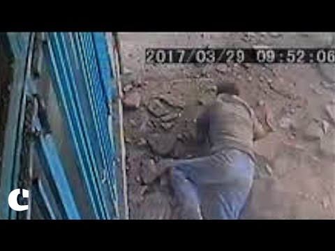 Sewer hole blows up in man's face as he drops cigarette butt in it in Tehran, Iran