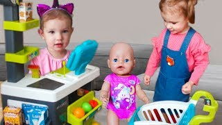 Funny baby Pretend Play Supermarket and doing Shopping with Baby Born Doll