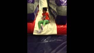 Coming down the slide @ Bounce U