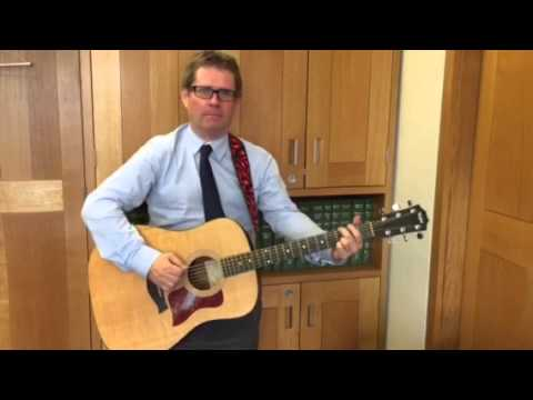 Kevin Brennan Shadow Minister for Business, Innovation and Skills plays guitar