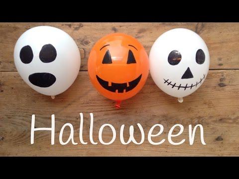 Decoración para halloween con globos de calabazas y calaveras
