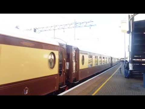 British Pullman 67024 departs Ashford platform 5 with the Orient express, 67021 on the rear