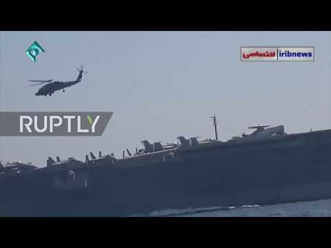Iran: Video emerges of close encounter between Iranian speedboats and US aircraft carrier