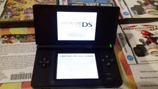 Ds lite con new super mario bros,mario kart y dk vs mario