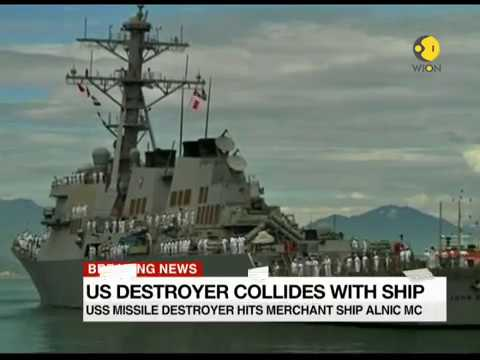 America's missile destroyer collides with merchant ship; Search and Rescue operation launched