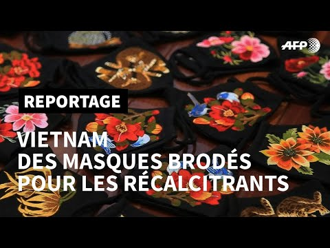 Coronavirus: une créatrice vietnamienne fabrique des masques brodés | AFP