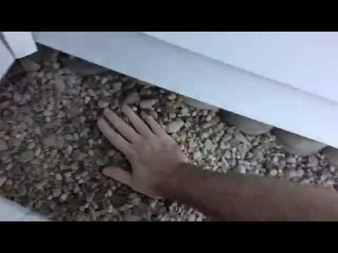 Landscaping with River Rock and Landscape Fabric How to Lay Stone and Building Block Retaining Walls