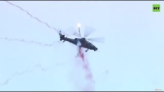 Helicopters perform stunts at 5th Expo in China