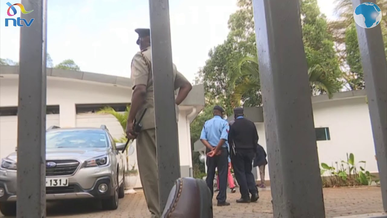 Police keep journalist and the public at bay at Cohen's home