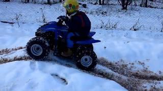 Dinli 50. Quad Christian nella neve.