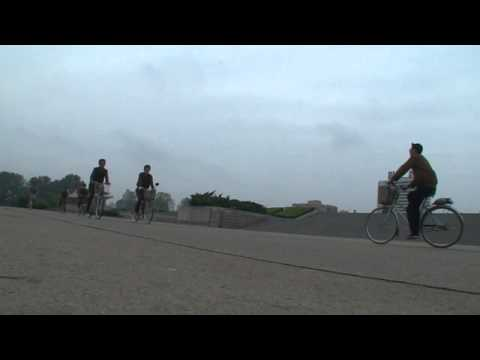 North korea documentary: Juche tower bicycle 4 North Korea Pyongyang