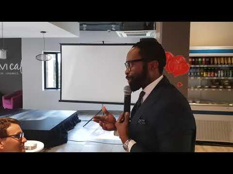 DJ Sbu talking to the staff at CAVI Brands
