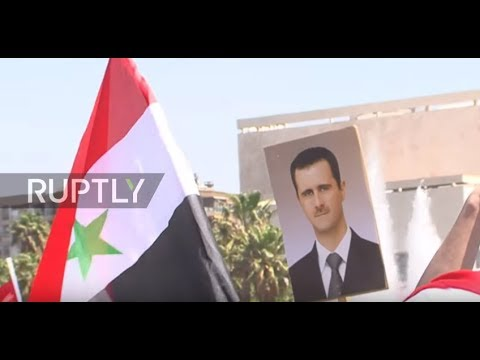 Syria: Damascus residents rally in support of Syrian armed forces