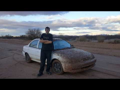 Mud Bogging and jumping the $300 Kia Sephia