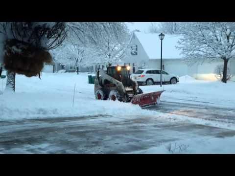 Bobcat skid steer plowing my drive!!