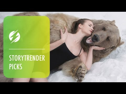 Russian Models Pose Next To Brown Bear