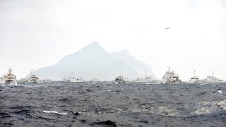 Japan Coast Guard claim 3 chinese fleets first time in 2015 patrol over Diaoyu Island