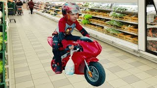 Funny Baby Shopping in Supermarket and Ride on Red Sport Bike Power Wheel for kids