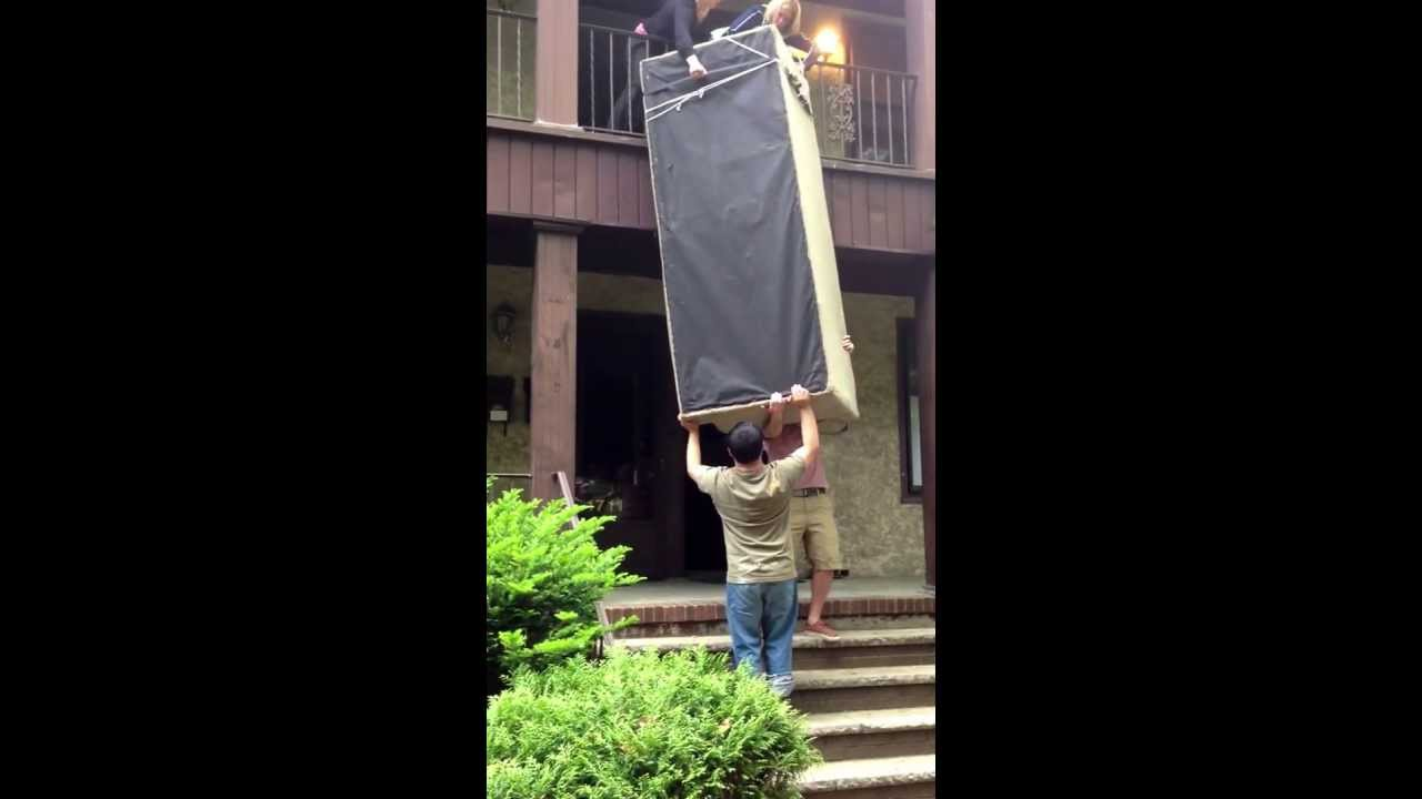 Students Moving Couch Over Balcony That S Too Long For Stairs