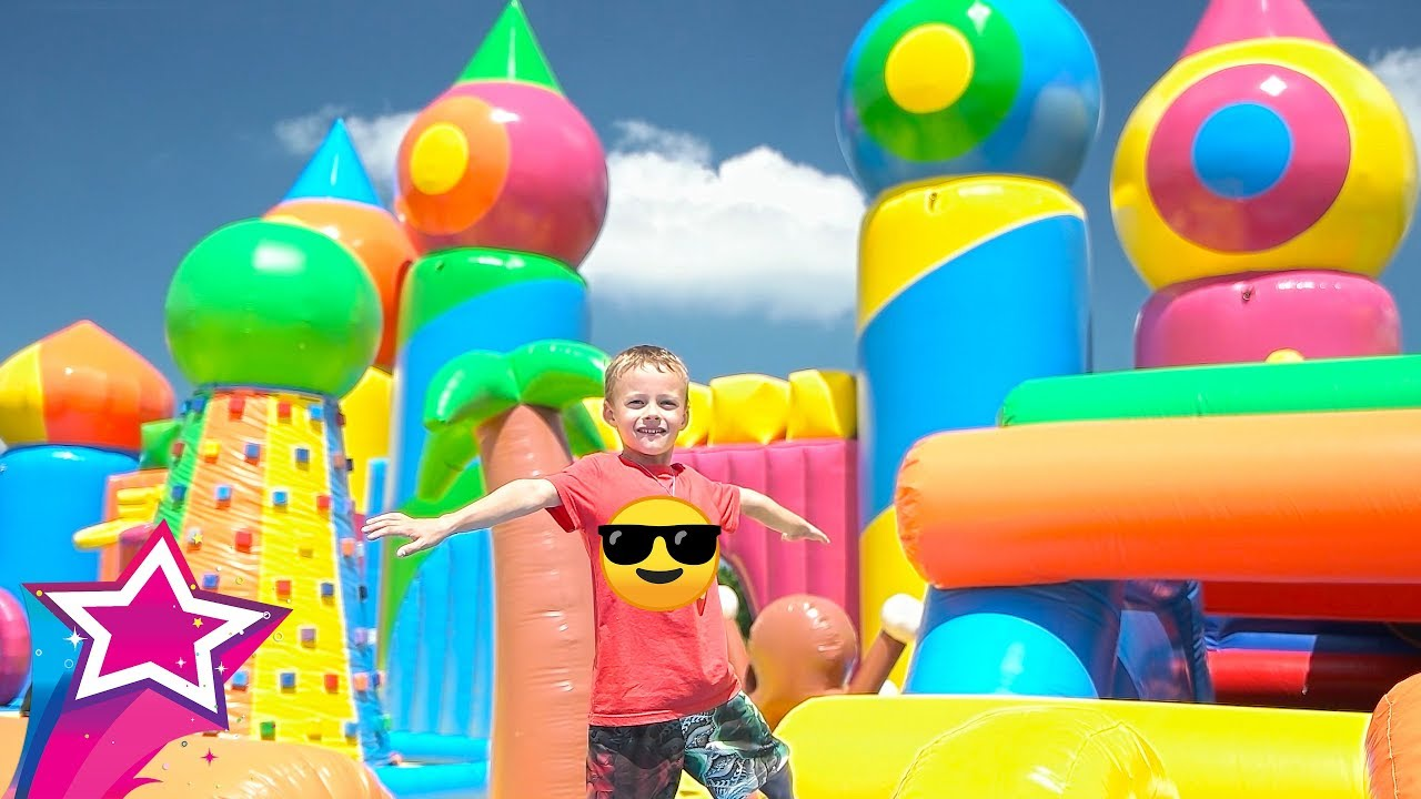 Mila and Max Playing at The Worlds BIGGEST Inflatable Bounce House for kids