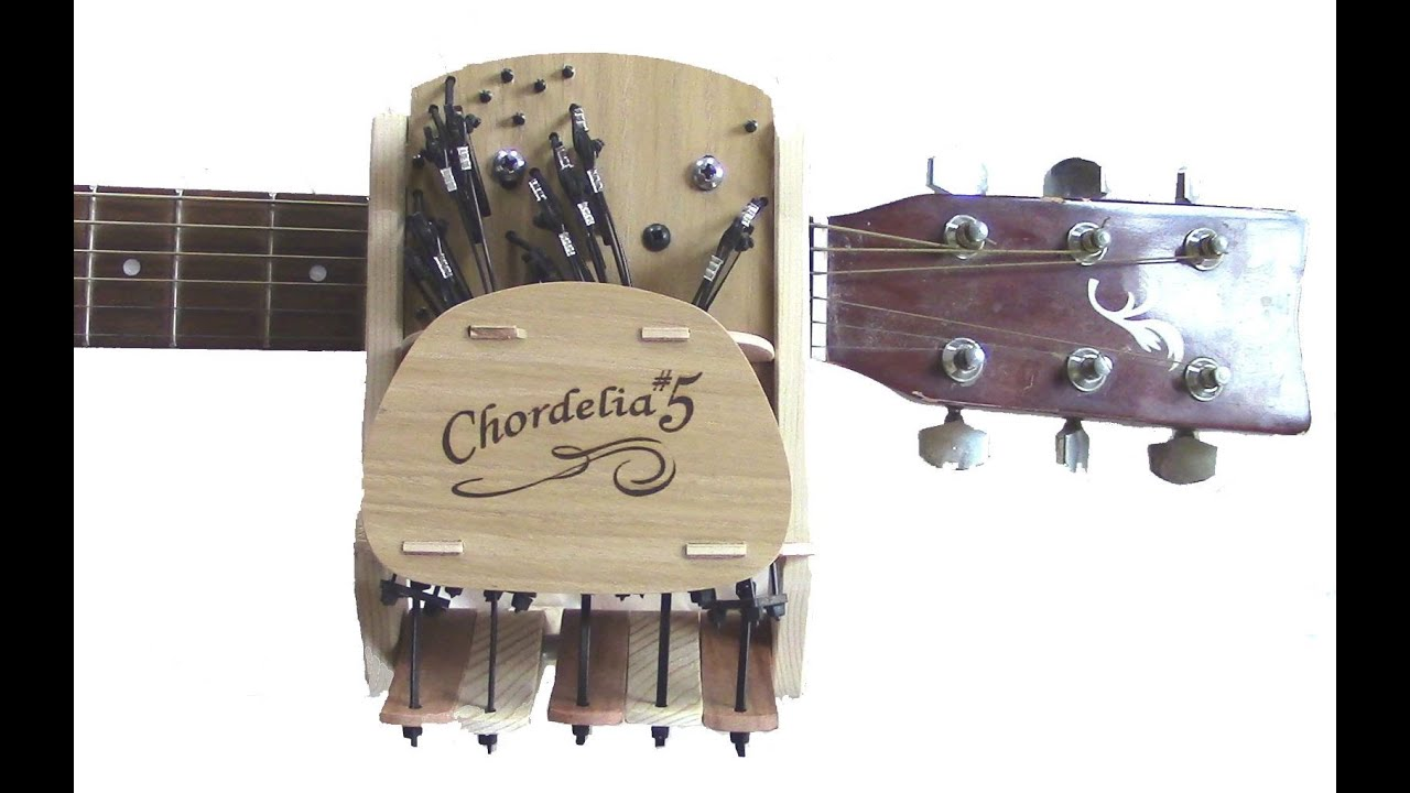 Ingenious Wooden Contraption Lets You Play Guitar Without Learning