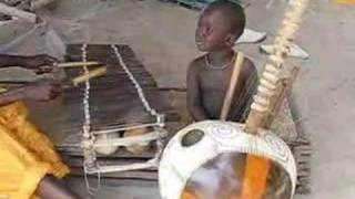 2 year old Gambian jali plays kora & balafon