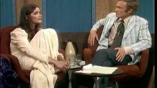 Margot Kidder reads a quote from Joan Garrity