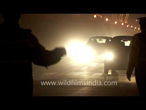Night traffic in Vijay Chowk at the backdrop of Rashtrapati Bhavan lit up with festive bulbs!