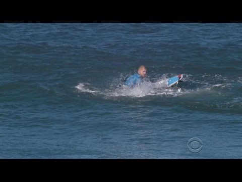 Pro surfer fights off shark during contest in South Africa