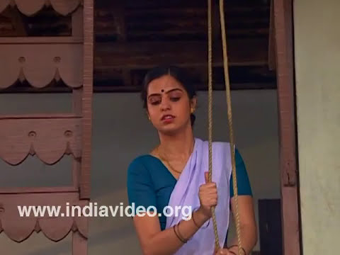Woman with mundu, blouse and thorthu