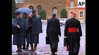 Cardinals arrive for meeting, tourists visit basilica